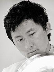Dr Martin H. S. Huang - image 0