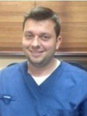 Dental Clinic O.C.I. - Tamarindo - Dr. Jose Solano - Oral Maxillofacial Surgeon